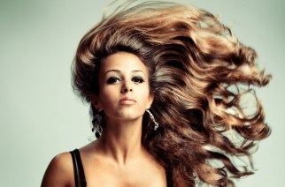 young sensual woman with long flying hair, studio shot
